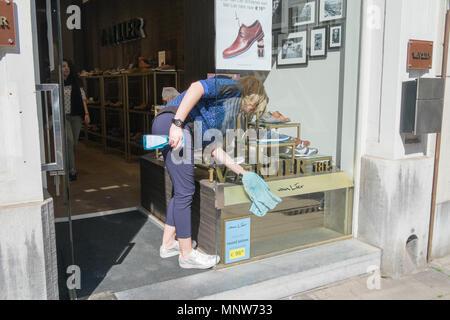 window cleaner washing windows in antwerp, belgium - Stock Photo