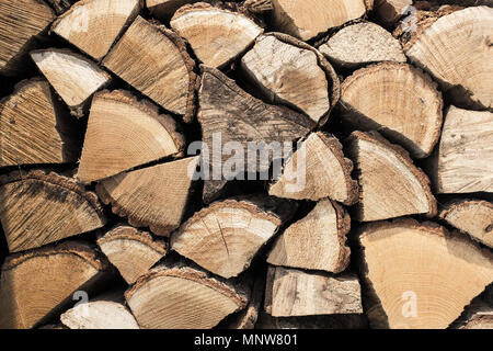 Abstract photo of a pile of natural wooden logs background, top view - Stock Photo