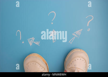 Where to go concept. sneakers on blue background - Stock Photo