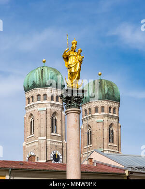 Marian column and the Frauenkirche cathedral of Munich - Stock Photo