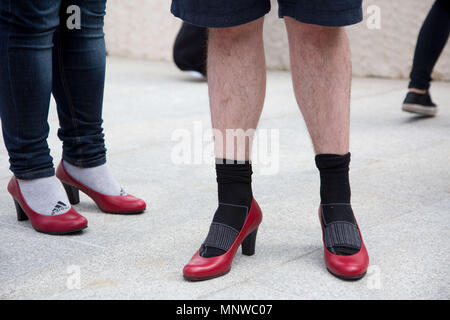 Sofia, Bulgaria. 19th May, 2018. Men wore high-heeled shoes in order to show solidarity with women and the struggles they face during the ''Walk a Mile in Her Shoes'' campaign to draw attention to the violence against women. The event, which drew a few dozen participants, was organized by the Bulgarian Fund for Women and other organizations dedicated to women's rights. Credit: Jodi Hilton/SOPA Images/ZUMA Wire/Alamy Live News - Stock Photo