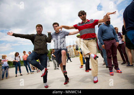 Sofia, Bulgaria. 19th May, 2018. Men pose wearing high-heeled shoes in order to show solidarity with women and the struggles they face during the ''Walk a Mile in Her Shoes'' campaign to draw attention to the violence against women. The event, which drew a few dozen participants, was organized by the Bulgarian Fund for Women and other organizations dedicated to women's rights. Credit: Jodi Hilton/SOPA Images/ZUMA Wire/Alamy Live News - Stock Photo