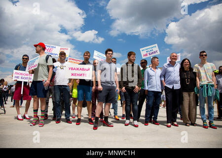 Sofia, Bulgaria. 19th May, 2018. Men wearing high-heeled shoes gathered in order to show solidarity with women and the struggles they face during the ''Walk a Mile in Her Shoes'' campaign to draw attention to the violence against women. The event, which drew a few dozen participants, was organized by the Bulgarian Fund for Women and other organizations dedicated to women's rights. Credit: Jodi Hilton/SOPA Images/ZUMA Wire/Alamy Live News - Stock Photo