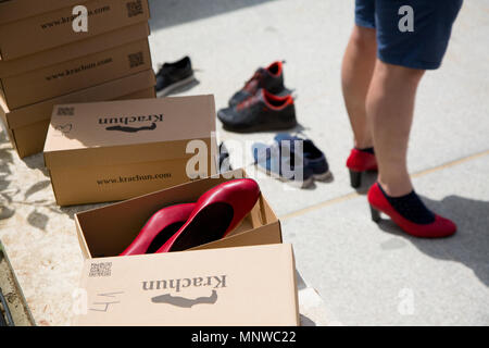 Sofia, Bulgaria. 19th May, 2018. High-heeled shoes in large sizes were provided to men who participated in the ''Walk a Mile in Her Shoes'' campaign to draw attention to the violence against women. The event, which drew a few dozen participants, was organized by the Bulgarian Fund for Women and other organizations dedicated to women's rights. Credit: Jodi Hilton/SOPA Images/ZUMA Wire/Alamy Live News - Stock Photo