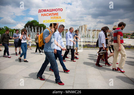 Sofia, Bulgaria. 19th May, 2018. Men wore high-heeled shoes and walked together in the center of Sofia in order to show solidarity with women and the struggles they face during the ''Walk a Mile in Her Shoes'' campaign to draw attention to the violence against women. The event, which drew a few dozen participants, was organized by the Bulgarian Fund for Women and other organizations dedicated to women's rights. Credit: Jodi Hilton/SOPA Images/ZUMA Wire/Alamy Live News - Stock Photo