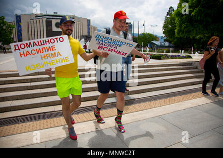 Sofia, Bulgaria. 19th May, 2018. Momchil Baev, left, and Luis Lomeli were among the participants in the ''Walk a Mile in Her Shoes'' campaign held in the center of Sofia. The event, in which men wore high-heeled shoes and walked in the center of Sofia was intended to show solidarity with women against domestic violence and raise awareness to the problems women oftentimes face. Credit: Jodi Hilton/SOPA Images/ZUMA Wire/Alamy Live News - Stock Photo