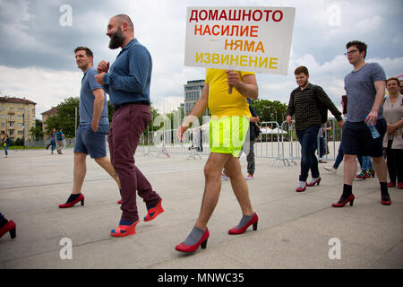 Sofia, Bulgaria. 19th May, 2018. Men wore high-heeled shoes and walked around the park holding signs like ''No Excuse for Domestic Violence'' in front of the National Palace of Culture in Sofia to show solidarity with women and the struggles they face during the ''Walk a Mile in Her Shoes'' campaign. The event, which drew a few dozen participants, was organized by the Bulgarian Fund for Women and other organizations dedicated to women's rights. Credit: Jodi Hilton/SOPA Images/ZUMA Wire/Alamy Live News - Stock Photo
