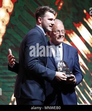 Belgrade, Serbia. 19th May, 2018. Real Madrid's Slovenian point guard Luka Doncic (L) receives the Euroleague 2018 Final Four Best Player award in Belgrade, Serbia, 19 May 2018. Credit: Luis Tejido/EFE/Alamy Live News - Stock Photo