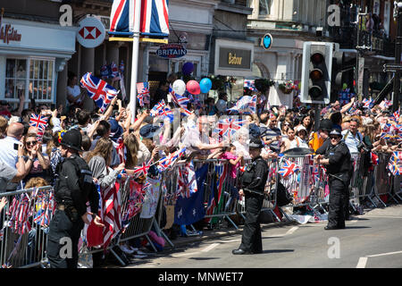 Windsor, UK. 19th May, 2018. Thousands of well-wishers line the streets of Windsor to witness the carriage procession of Prince Harry and Meghan Markle, now the Duke and Duchess of Sussex, following their wedding at St George's Chapel in Windsor Castle. Credit: Mark Kerrison/Alamy Live News - Stock Photo