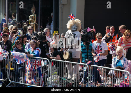 Windsor, UK. 19th May, 2018. Thousands of well-wishers line the streets of Windsor to witness the carriage procession of Prince Harry and Meghan Markle, now the Duke and Duchess of Sussex following their wedding at St George's Chapel in Windsor Castle. Credit: Mark Kerrison/Alamy Live News - Stock Photo