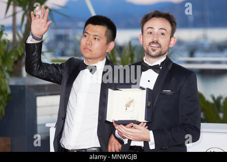 Australian director Charles Williams (R), short film Palm d'Or award winner for his film 'All These Creatures' poses with Wei Shujun (L) special mention award winner for his film 'Border' at the photocall the Palme D'Or Winner during the 71st annual Cannes Film Festival at Palais des Festivals on May 19, 2018 in Cannes, France. (Photo by Oleg Nikishin) - Stock Photo