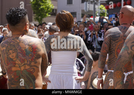 Tokyo, Japan. 20th May 2018. Participants showing their full body tattooed, possibly members of the Japanese mafia or Yakuza, attend the Sanja Matsuri in Asakusa district. The Sanja Matsuri is one of the largest Shinto festivals in Tokyo, and it is held in Tokyo's Asakusa district for three days around the third weekend of May. Credit: ZUMA Press, Inc./Alamy Live News - Stock Photo