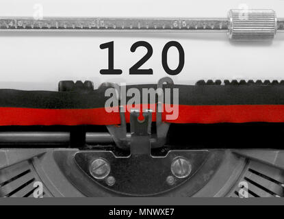 120 Number text written by an old typewriter on white sheet - Stock Photo