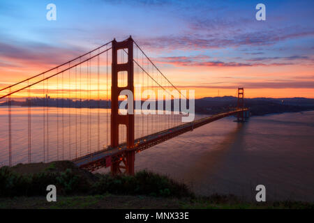 The iconic Golden Gate Bridge during a beautiful sunrise. - Stock Photo