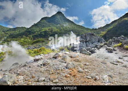 Hot spring vents at Owakudani valley at Hakone in Japan - Stock Photo