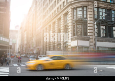 New York City yellow taxi cab speeding down Broadway in Manhattan NYC - Stock Photo