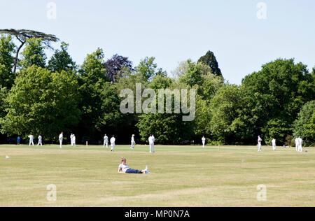 village cricket match scene being played on Englefield green, Egham, Surrey/ Berkshire border, England, UK - Stock Photo