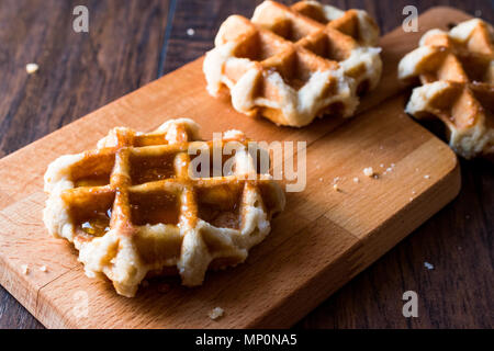 Belgium Waffle with Maple Syrup on wooden surface. Traditional Food. - Stock Photo