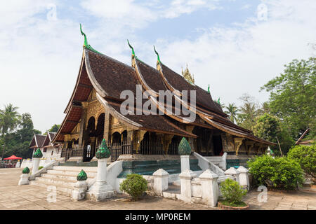View of the Buddhist Wat Xieng Thong temple ('Temple of the Golden City') in Luang Prabang, Laos. - Stock Photo