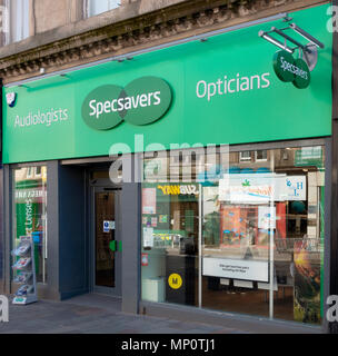 Frontage and entrance to a branch of Specsavers opticians and audiologists in Hamilton, South Lanarkshire, Scotland, UK - Stock Photo