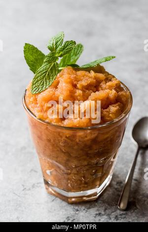 Homemade Italian Mandarin Granita Ice Cream with Mint. Organic Food. - Stock Photo