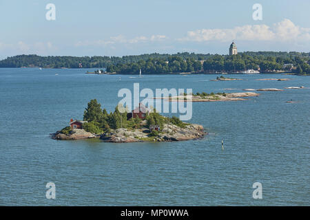 Houses surrounded by water and the banks of the Gulf of Finland near the port of Helsinki in Finland. - Stock Photo