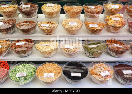 Various Nuts and Dried Fruits in Bowls For Sale - Stock Photo