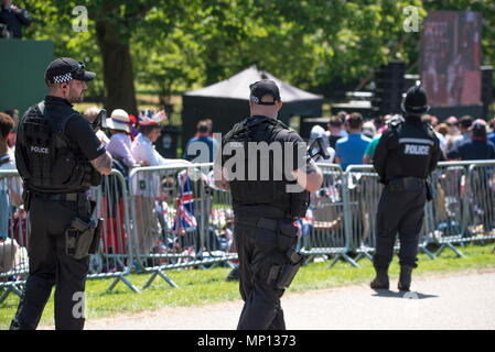 19 May 2018 - Armed police, security, and other protection officers patrol the Long Walk during the royal wedding in Windsor Castle of Prince Harry and Meghan Markle. - Stock Photo
