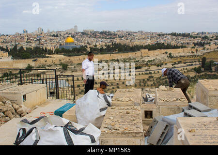 8 May 2018 Men opening a grave in the Jewish holy cemetery on the Mount of Olives in Jerusalem Israel - Stock Photo