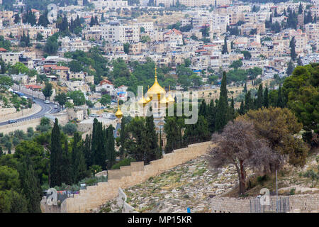 The golden rooftops of the towers on the ancient Russian Orthodox Church in the City of Jerusalem in Israel seen from the Mount of Olives - Stock Photo
