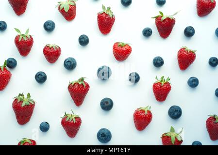 strawberry and blueberry patter backgriund, heakthy vegan snack, diet organic food, detox, flatlay - Stock Photo