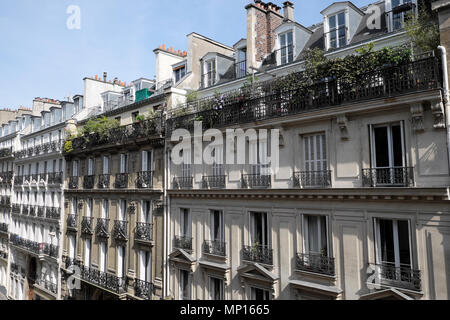 Exterior view of a row of apartment buildings with plants on balconies in the Rue Pierre Semard Paris 9th arrondissemnt France Europe EU  KATHY DEWITT - Stock Photo