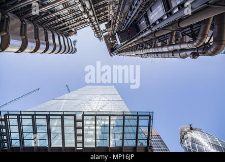 Looking up at The Leadenhall Building (bottom), 122 Leadenhall Street, the Lloyds Building (top) and the Gherkin in London. - Stock Photo
