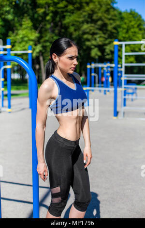 strong athletic woman on sport playground - Stock Photo