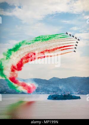 The Italian Aerobatic Display Team the Frecce Tricolori formation flying over the Lake Maggiore, Verbania, Italy - Stock Photo