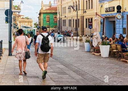 Olbia, Italy - September 11, 2017: People and street cafe at Corso Umberto Street in Olbia, Sardinia, Italy - Stock Photo