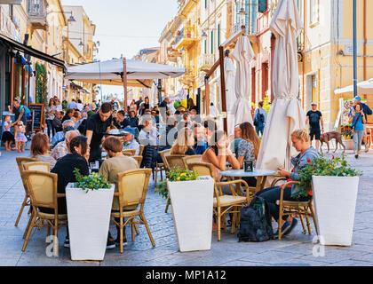 Olbia, Italy - September 11, 2017: Tourists at street cafe on Corso Umberto Street in Olbia, Sardinia, Italy - Stock Photo