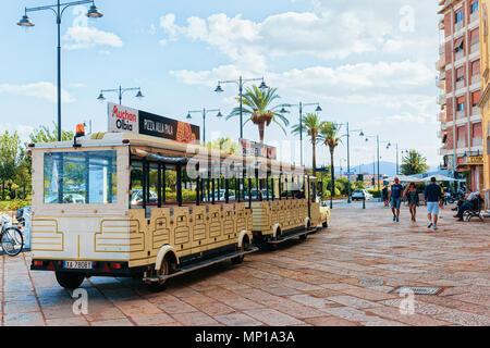 Olbia, Italy - September 11, 2017: Excursion tram on Corso Umberto I in the old city of Olbia, Sardinia, Italy - Stock Photo