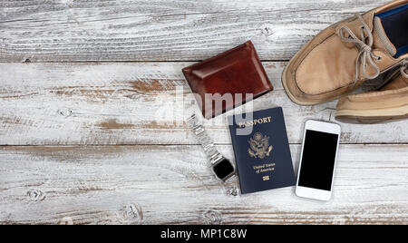 Travel related objects on white faded wood - Stock Photo