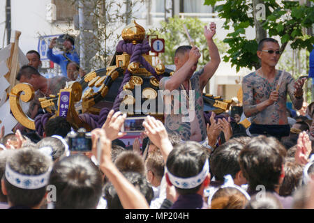Tokyo, Japan. 20th May 2018. Participants showing their full body tattooed, possibly members of the Japanese mafia or Yakuza, with their portable shrine during the Sanja Matsuri in Asakusa district on May 20, 2018, Tokyo, Japan. The Sanja Matsuri is one of the largest Shinto festivals in Tokyo, and it is held in Tokyo's Asakusa district for three days around the third weekend of May. Credit: Rodrigo Reyes/Alamy Live News - Stock Photo