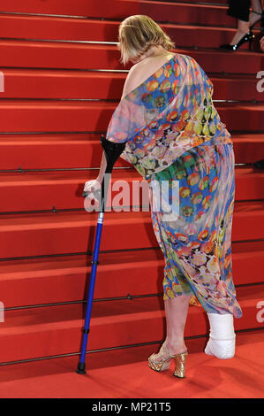 Cannes, France. 14th May, 2018. 14.05.2018, France, Cannes: Guest with crutches attends the screening of 'The House That Jack Built' during the 71st annual Cannes Film Festival at Palais des Festivals. · NO WIRE SERVICE · Credit: Stefanie Rex/dpa-Zentralbild/dpa/Alamy Live News