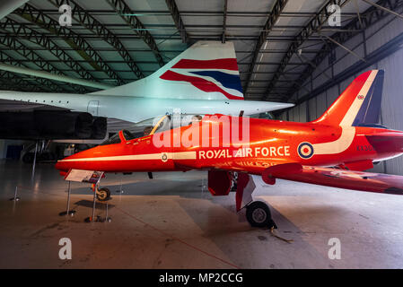 British Airways Concorde and Red Arrows Hawk on display in hanger at National Museum of Flight at East Fortune Airfield in East Lothian, Scotland, Uni - Stock Photo