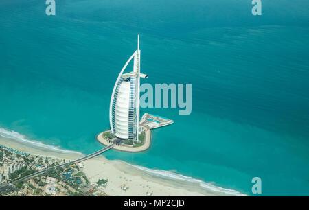 Dubai, UAE - May 18, 2018: Aerial view of Burj Al Arab luxury hotel on the coast of Persian Gulf on a clear sunny day. - Stock Photo