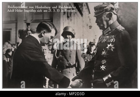 ADOLF HITLER-HINDENBURG 1933 Recently appointed as German chancellor, Adolf Hitler greets President Paul von Hindenburg in Potsdam, Germany, on March 21, 1933. This pose was designed to project an image of Hitler as non-threatening to the established order. This particular image is from a widely used popular postcard. Hitler appears in civilian dress, bowing  to the heavily decorated von Hindenburg. The March 5, 1933, elections had given legitimacy and power to Hitler's leadership. - Stock Photo