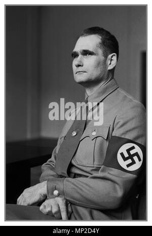 1930's Vintage historic formal portrait of Rudolf Hess wearing a Nazi Swastika Armband. Hess was a prominent politician in Nazi Germany. Appointed Deputy Führer to Adolf Hitler in 1933, he served in this position until 1941, when he flew solo to Scotland in an attempt to negotiate peace with the United Kingdom during World War II. He was taken prisoner and eventually was convicted of crimes against peace, serving a life sentence in Spandau prison until his suicide - Stock Photo