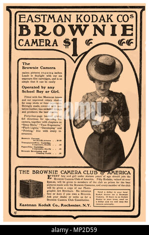 """1900's Vintage Press Ad for Eastman Kodak Company 'The Kodak Brownie camera'. It featured a simple """"meniscus"""" lens that took 2¼-inch square pictures on 117 roll film. It sold for only $1. It was easy to operate too. To take a picture you held the camera at waist height, aimed at your subject, and turned a switch. The film was affordable for consumers and profitable for Kodak. For 15 cents, a $1 Brownie camera owner could buy a six-exposure film cartridge that could be loaded in daylight and processed by Eastman Kodak Company In 1900 Eastman Kodak Company sold over 250000 Brownie cameras - Stock Photo"""
