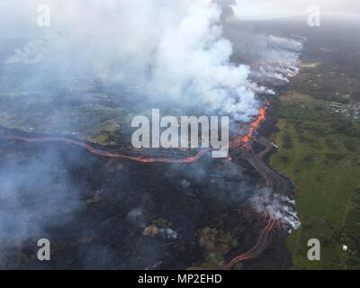 Channelized lava emerges from the elongated fissure 16-20 from the eruption of the Kilauea volcano May 19, 2018 in Pahoa, Hawaii. - Stock Photo
