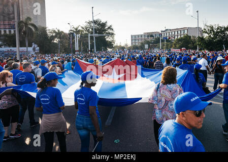 Havana, Cuba. May 1st 2018 Marchers in the International Worker's Day March  marching with the Cuban flag.  Caleb Hughes/Alamy Live News - Stock Photo