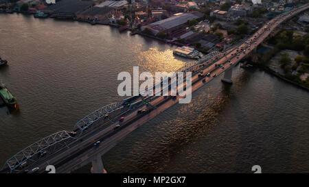 A drone image taken over a bridge in Bangkok, Thailand - Stock Photo