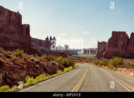 Vintage toned picturesque American desert highway in daylight with clear sky for copyspace. Concept for travel and freedom - Stock Photo